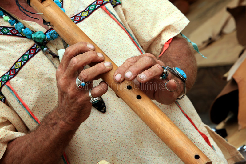 Native American flute Player stock image