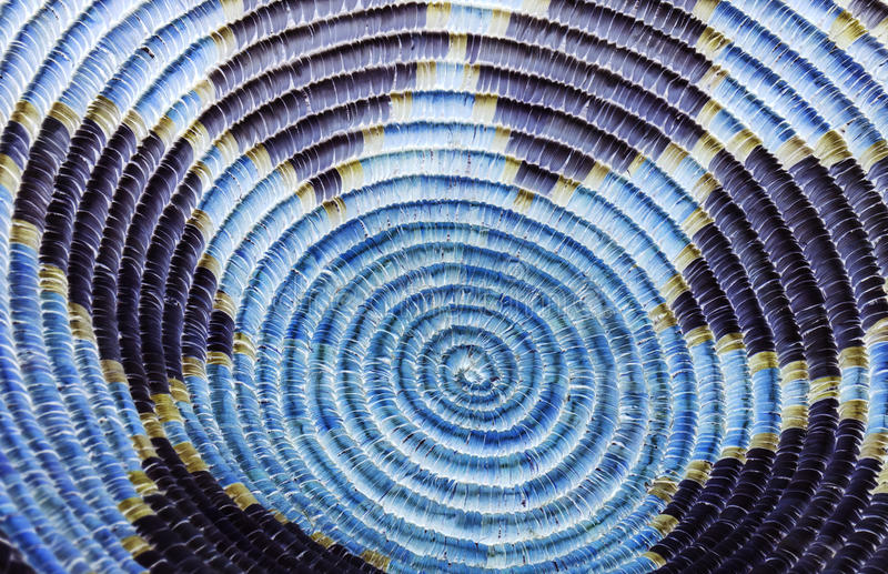 Native American Indian Basket Detail in Blue and Purple. A close up photo of an indian basket with rich straw textures, circular patterns and colorful shapes stock photos