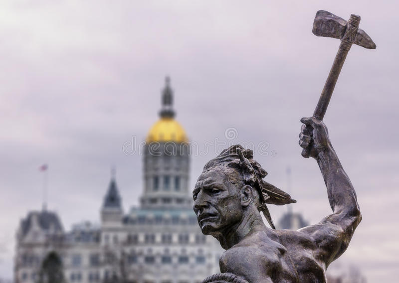 Native american Indian statue with axe at state capitol building royalty free stock photography