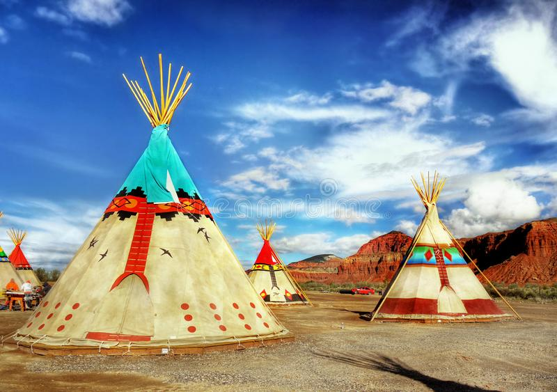 Native American Indian Tents Teepee. Native American Indian tents - teepee, decorated with ornaments in desert landscape. USA stock photo