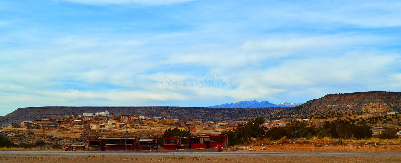 A Native American (Indian) Village. Laguna Pueblo, a Native American village in New Mexico with San Jose Mission-- a white church sitting on the hill royalty free stock photos