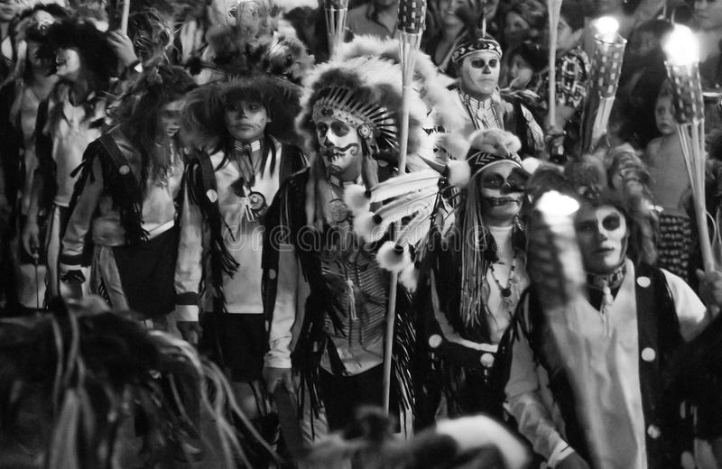 Native american indian warrior traditional custome parade with lights culture tribes royalty free stock images