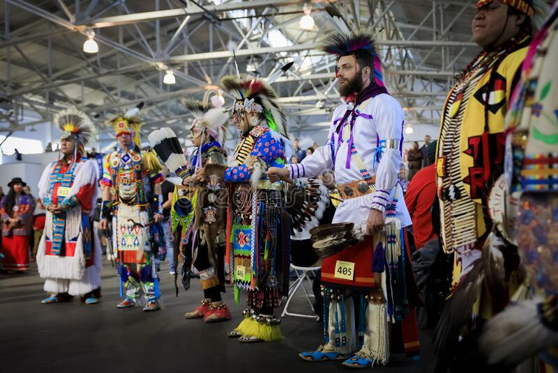 Native American Indians dressed in intricate and colorful traditional outfits dancing at a powwow in San Francisco, USA. San Francisco, USA - February 08, 2020 stock photos