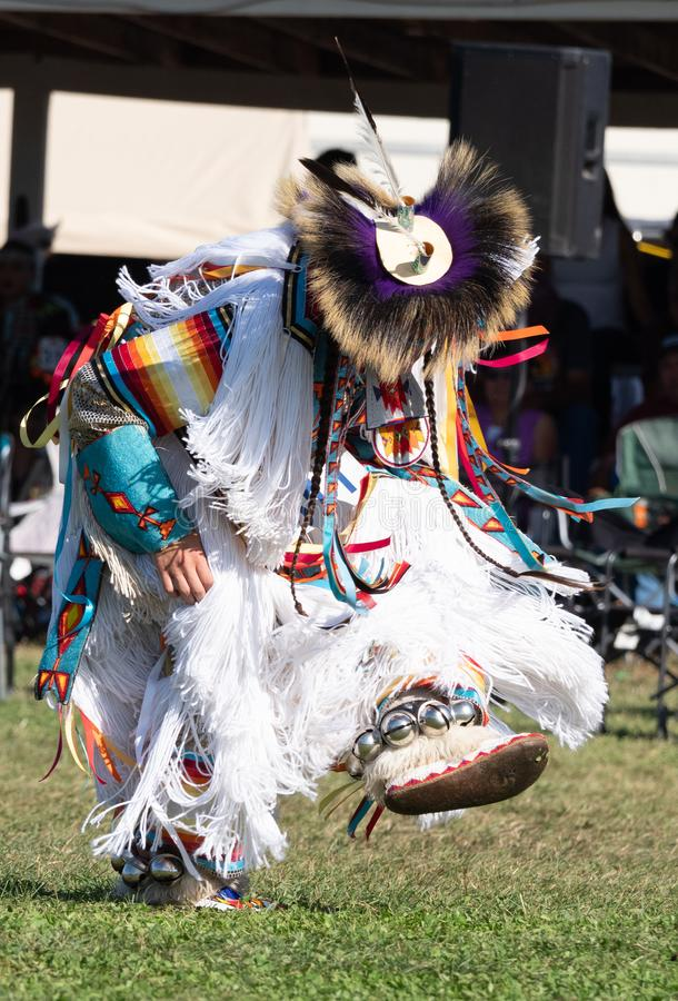 Native American Man Dancing at Pow Wow with Bells Around Ankles stock photography