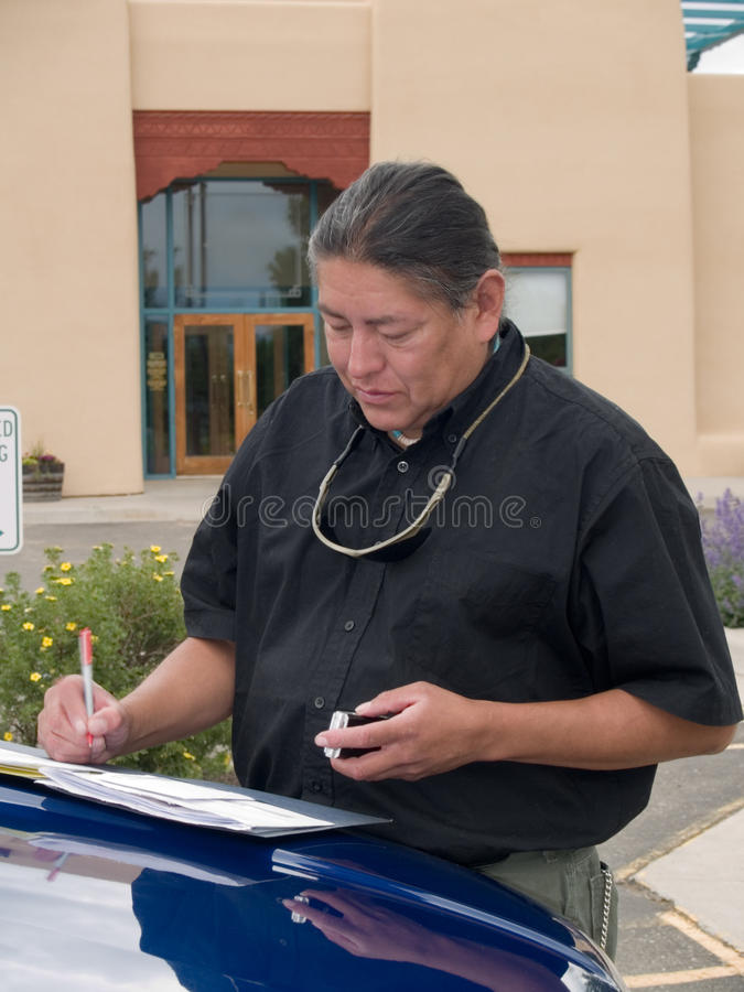 Native American man writing notes royalty free stock images