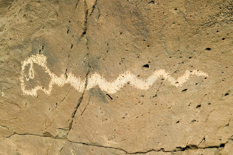 Native American petroglyphs featuring an image of a snake at Petroglyph National Monument, outside Albuquerque, New Mexico stock image
