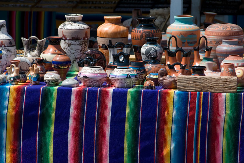 Native american pottery. On colorful display table stock photography