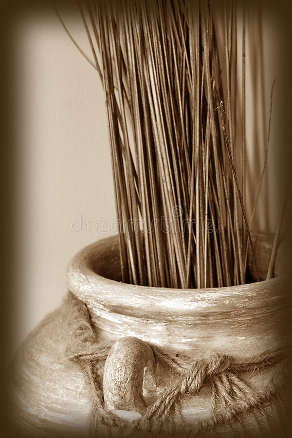 Native american pottery. Sepia tone image of native american vase royalty free stock image
