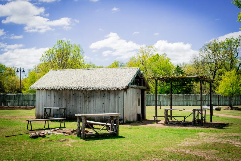 Native American summer house and grounds. Native American summer house, arbor, tables and grounds in the Chickasaw Living Village in Sulphur, Oklahoma royalty free stock photo