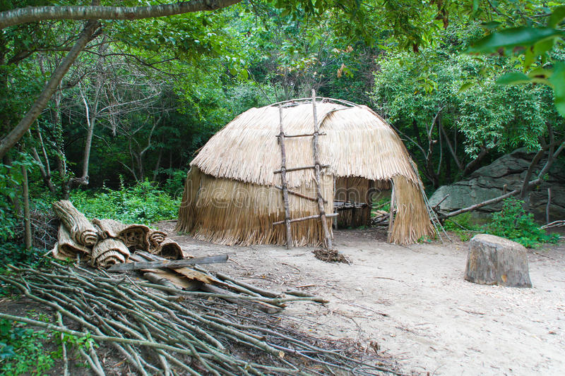 Native American wigwam. Hut in woods stock images