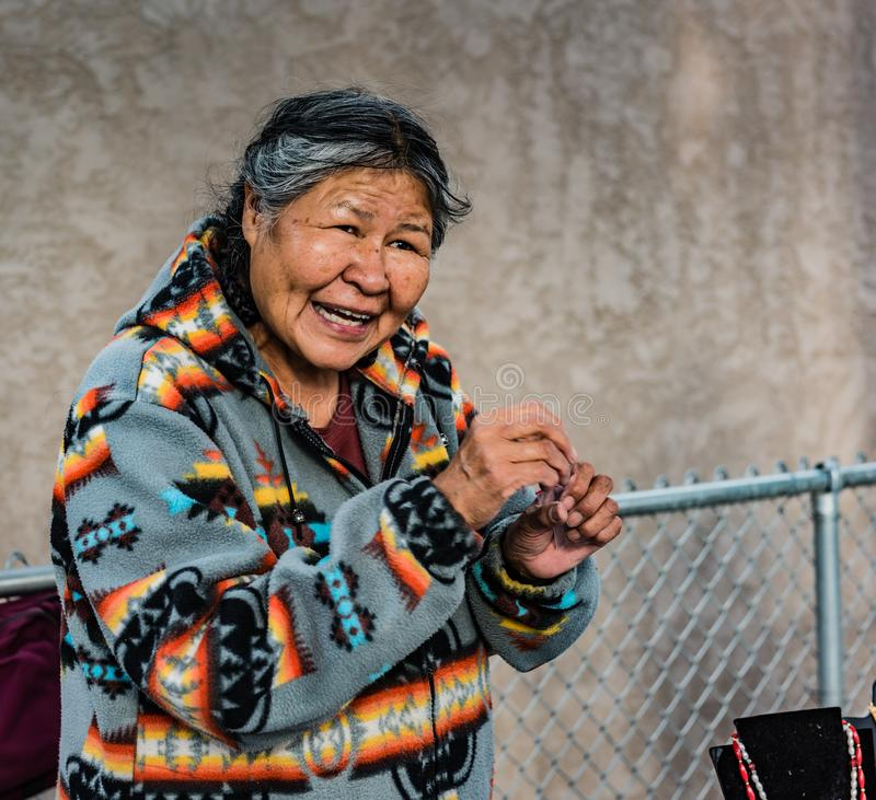 Native American Woman In Albuquerque NM. Albuquerque, New Mexico / USA / April 1, 2016: Native American woman selling hand crafted jewelry at the train station stock photo