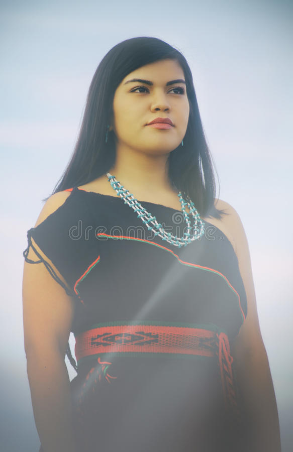 Native American Woman. Portrait of native American woman in traditional costume stock photos