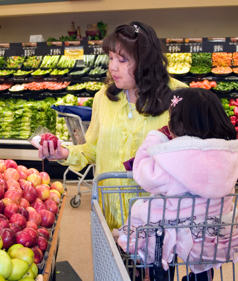 Native American woman shopping produce royalty free stock images