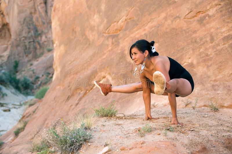Native American Yoga Woman In Firefly Pose royalty free stock photography