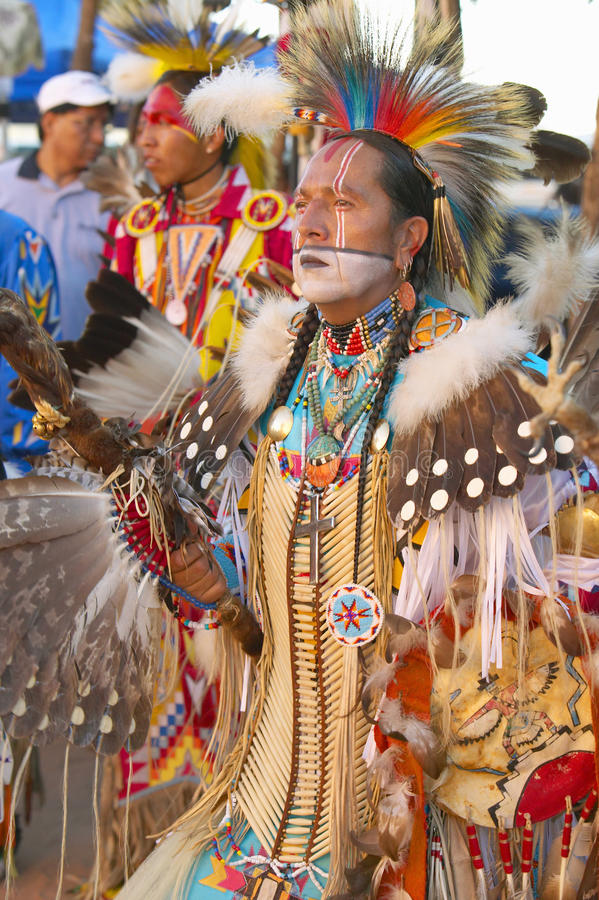 Native Americans in full regalia dancing at Pow wow stock photos