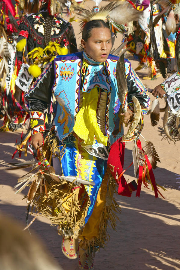 Native Americans in full regalia dancing at Pow wow stock image