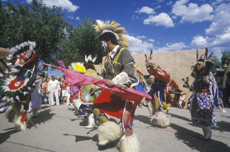 Native Americans in traditional costume performing Corn Dance ceremony in Santa Clara Pueblo, NM royalty free stock photo