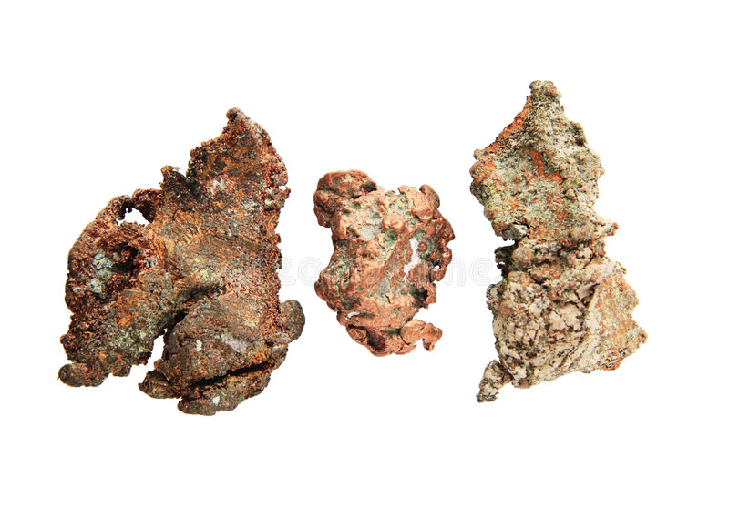 Native copper nuggets. Three small native copper nuggets isolated on white royalty free stock image