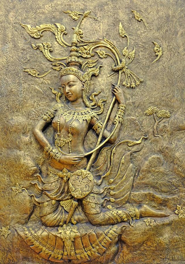 Native culture Thai sculpture on the temple wall stock images