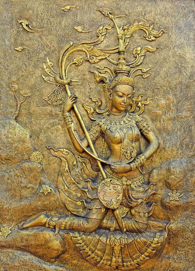 Native culture Thai sculpture on the temple wall royalty free stock photography