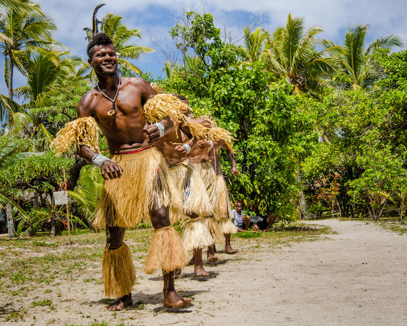 Native dancers entertain tourists visiting Mystery Island. royalty free stock photography