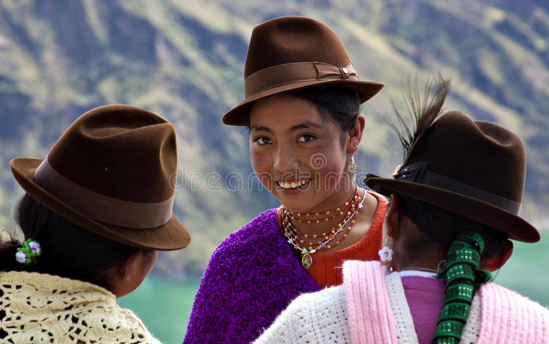 Native girls in Ecuador. Girls from the indigenous ethnic group of Kichwa, wearing traditional hats and colored clothes. The Quechuas - Kichwa people are more