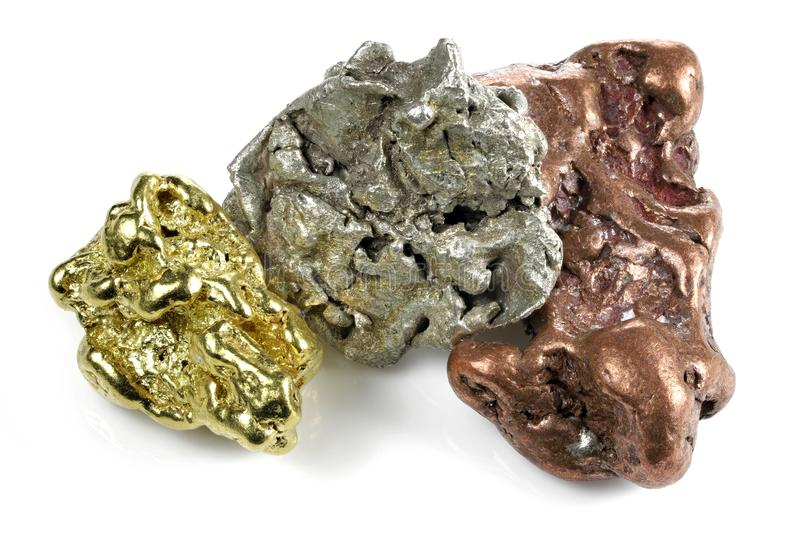 Gold, silver and copper nuggets royalty free stock photos