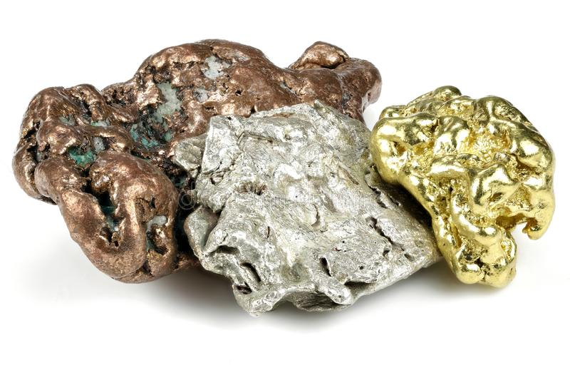 Gold, silver and copper nuggets stock photography