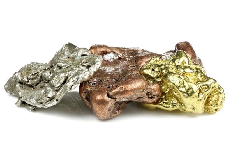 Gold, silver and copper nuggets royalty free stock image