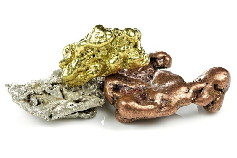 Gold, silver and copper nuggets royalty free stock photo