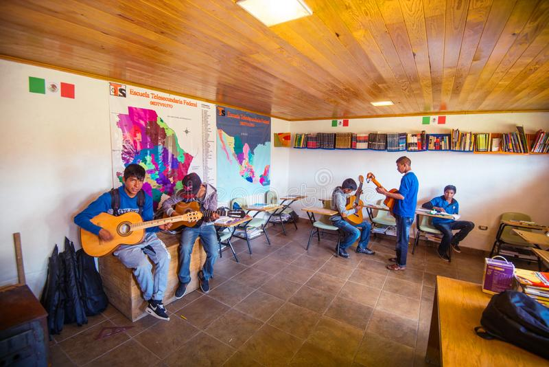 Native Indigenous student boy group play music course in school class room, Mexico, America royalty free stock photography