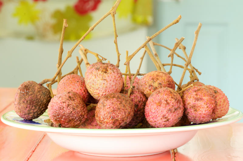 Native lychees. Fresh native lychees on plate royalty free stock photos