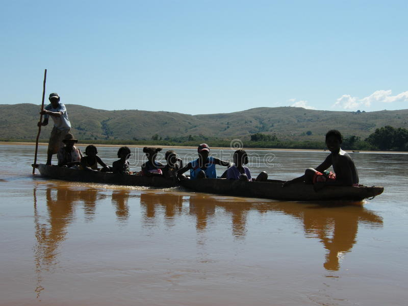 Native Malagasy people crossing river stock photography