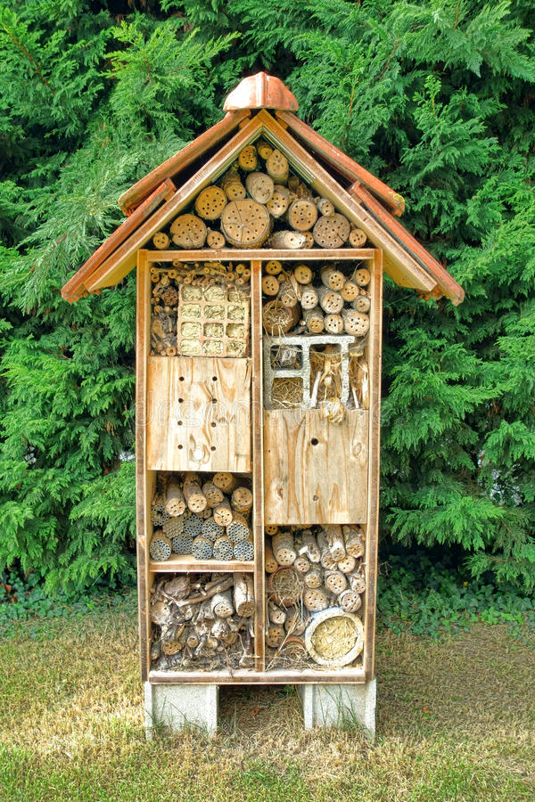 Native Mason Bee Nesting Box Tree House Complex. Native mason bee pollination and housing nesting box tree made of wood as a house complex for attracting royalty free stock photos