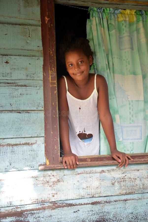Native Nicaraguan girl smiling clapboard house Big Corn Island. Native Nicaraguan Creole black girl smiling at clapboard house Big Corn Island Nicaragua Central royalty free stock photo