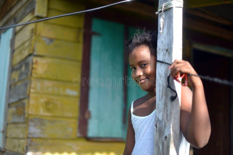 Native Nicaraguan girl smiling clapboard house Big Corn Island. Native Nicaraguan Creole black girl smiling at clapboard house Big Corn Island Nicaragua Central royalty free stock images