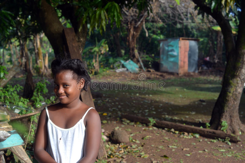 Native Nicaraguan girl smiling clapboard house Big Corn Island. Native Nicaraguan Creole black girl smiling at clapboard house Big Corn Island Nicaragua Central royalty free stock image