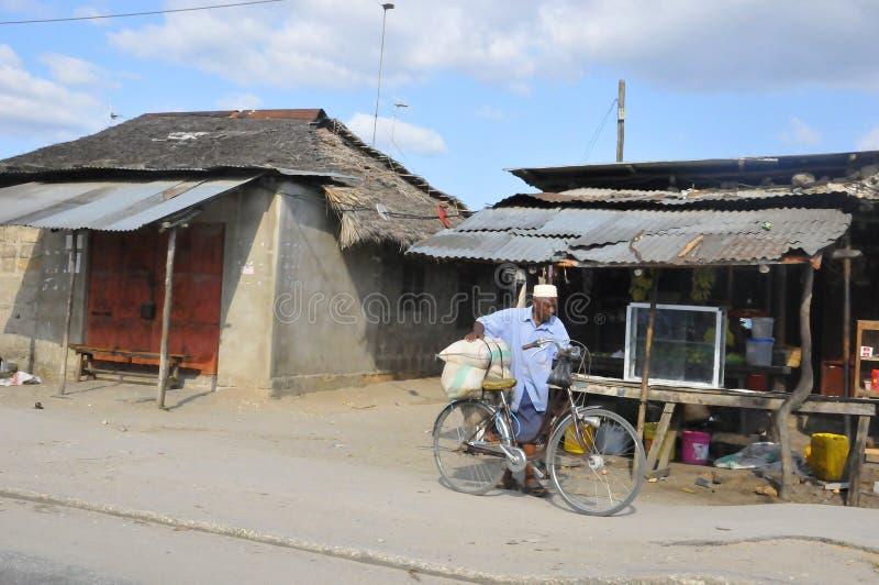Native people made affairs. ARUSHA, TANZANIA - NOVEMBER 25: Native people made affairs near main road on November 25, 2011 in Arusha, Tanzania. Arusha is a city stock image