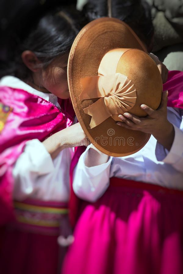 Native people from peruvian city dressed in colorful clothing perform traditional dance in a religious celebration. Peru, South Am stock image