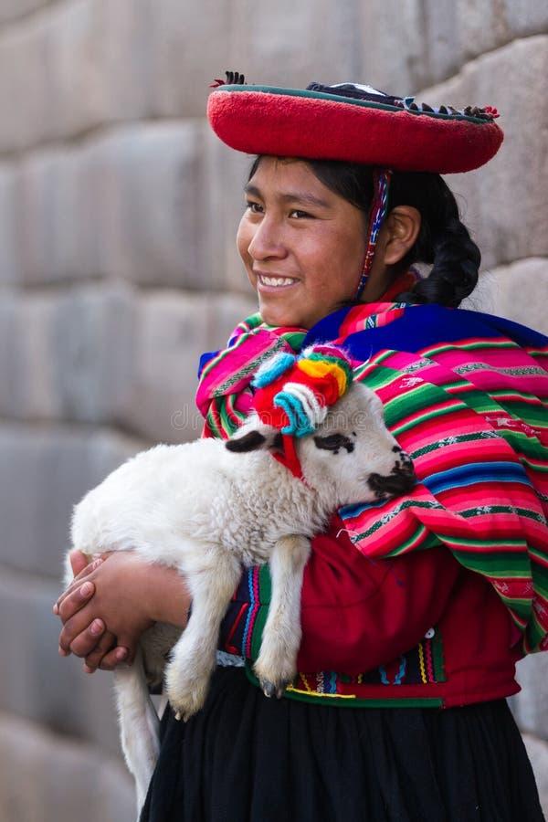 Free Native Peruvian Holding A Baby Lamb Royalty Free Stock Photos - 79764298