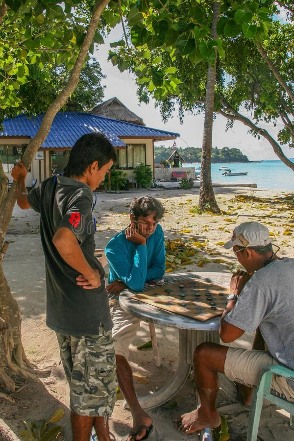 The native playing chess in phi phi island ,thailand royalty free stock photo