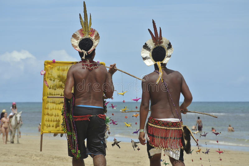 Native south american indians on the beach royalty free stock photos