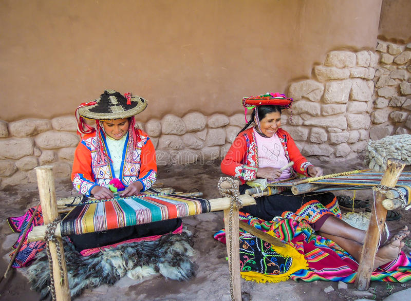 Native weavers at Awana Kancha, Peru. stock photo