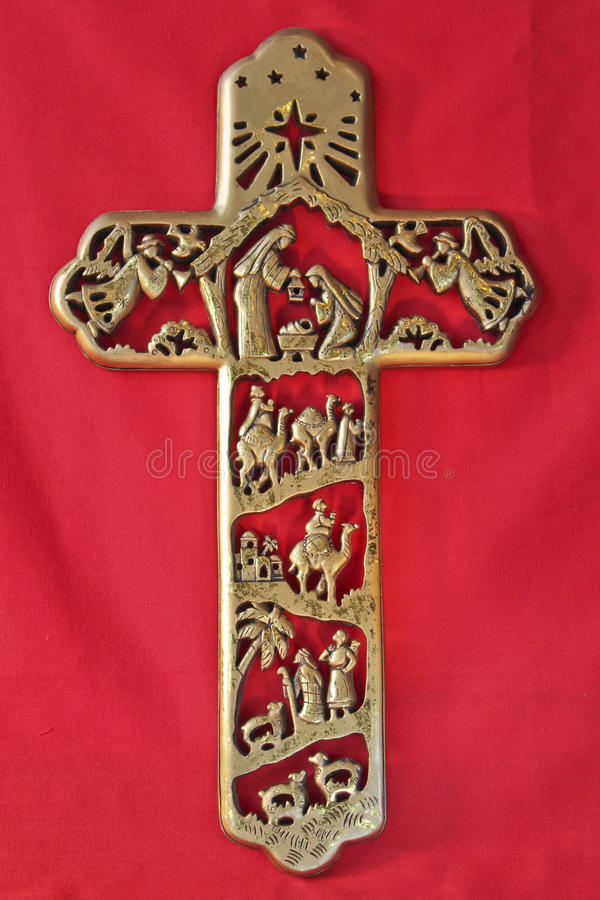 Nativity Cross on red Textile. Nativity Cross on a red background royalty free stock photos