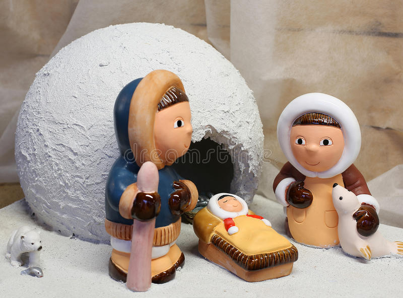 Nativity scene with the Eskimos to the north pole. And a white ice igloo stock images