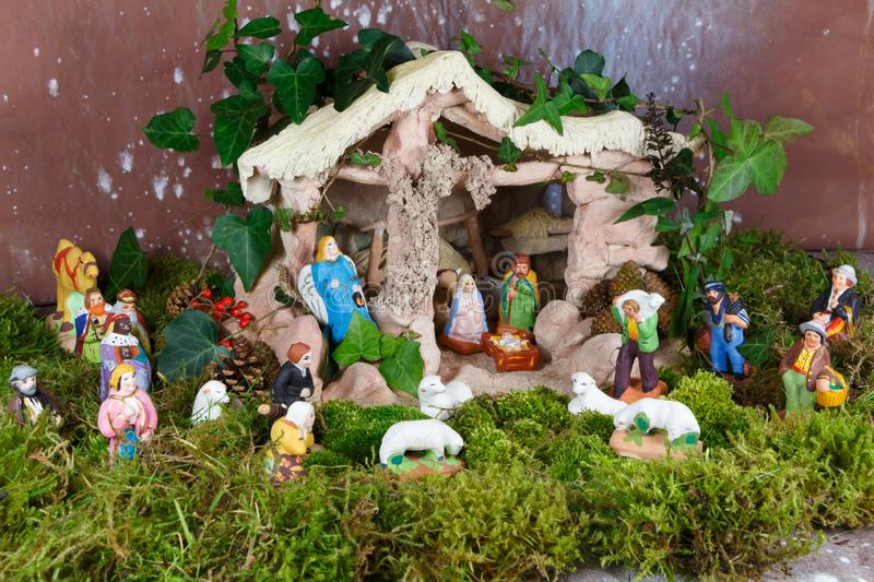 Nativity scene with provencal Christmas crib figures. In terracotta royalty free stock images