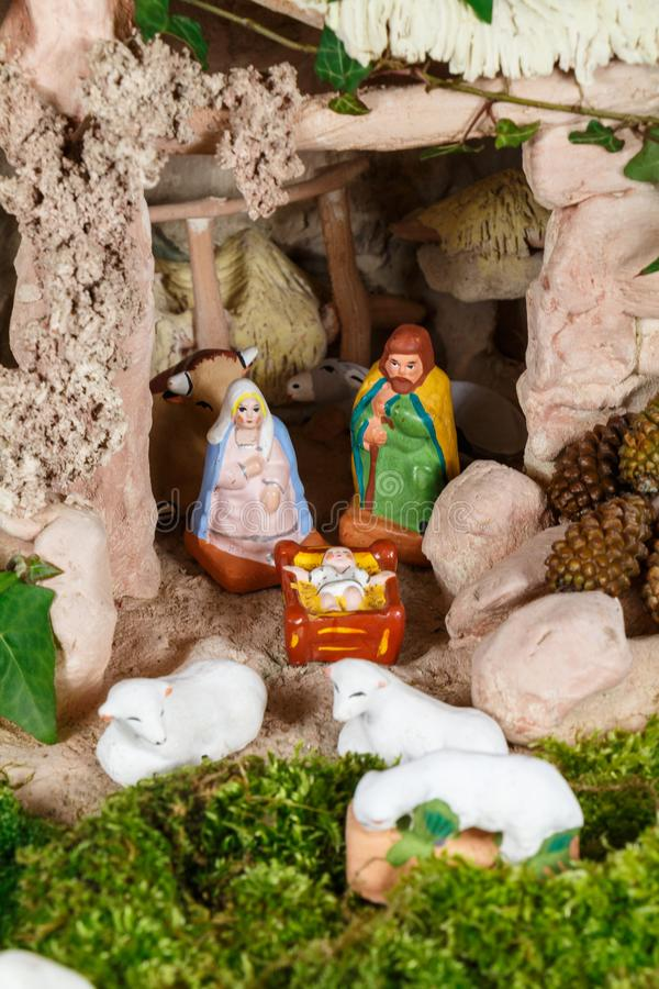 Nativity scene with provencal Christmas crib figures. In terracotta royalty free stock photo