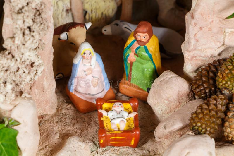 Nativity scene with provencal Christmas crib figures. In terracotta stock photos