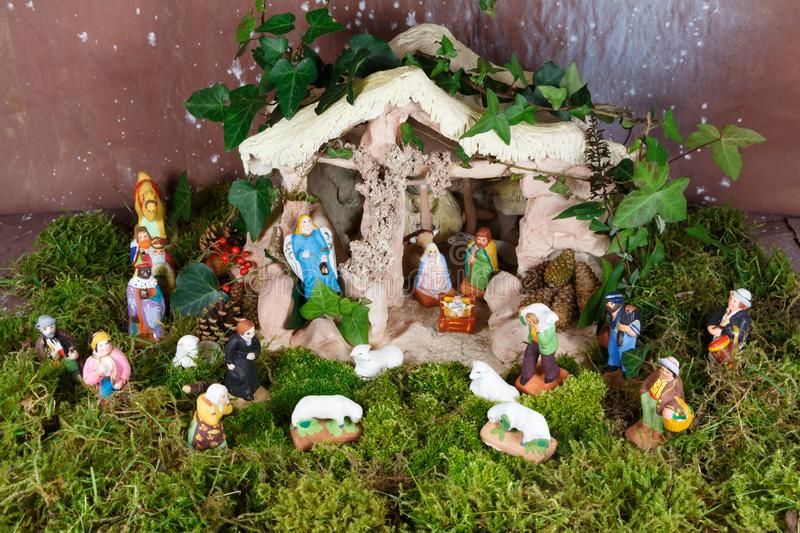 Nativity scene with Christmas crib figures. Nativity scene with provencal Christmas crib figures in terracotta stock images