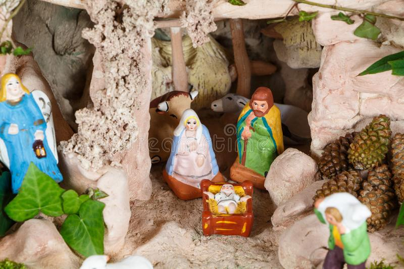 Nativity scene with provencal Christmas crib figures. In terracotta stock photo